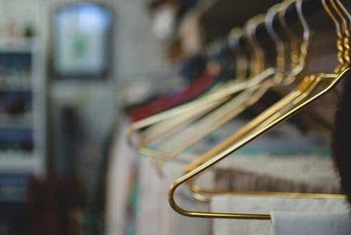 best luxury tops: brass hangers in wardrobe
