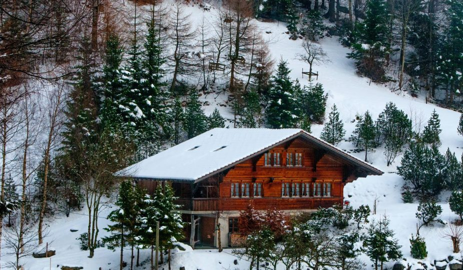 staying in a chalet: chalet on a snowy mountain
