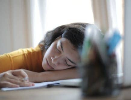 boost your energy leves: woman asleep at a desk in front of a computer