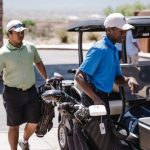 guide to men's golf fashion: 2 male golfers getting into a golf cart