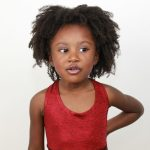 young girl with afro hair. Natural hair care.
