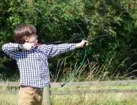 archery: boy with a bow and arrow