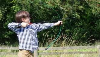 archery: boy with a bow and arrow