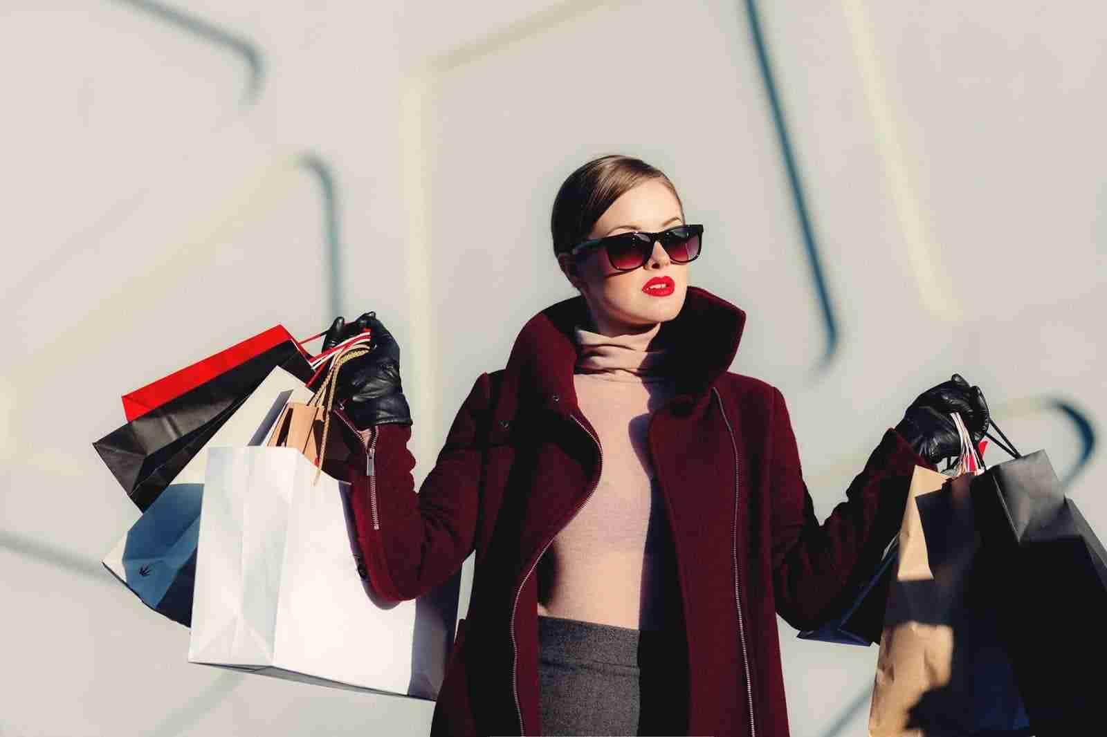 magic behind fashion. Woman holding shopping bags.