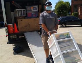 Your move: man loading palettes onto truck.
