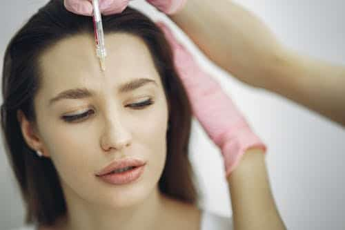 woman receiving botox injection: botox process in Las Vegas