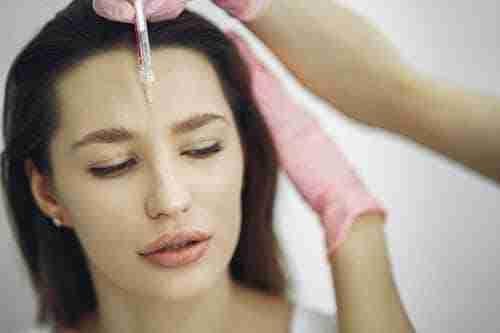 woman receiving botox injection: botox process in Las Vegas