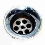 silver plughole: down the drain