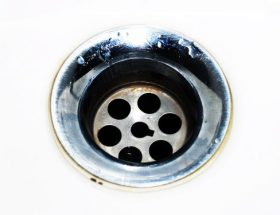 silver plughole: down the drain