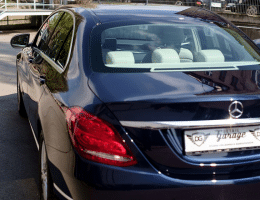 new car savings: brand new black mercedes