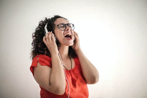 singing: woman with headphones singing.