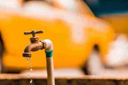 water line leak: dripping brass tap