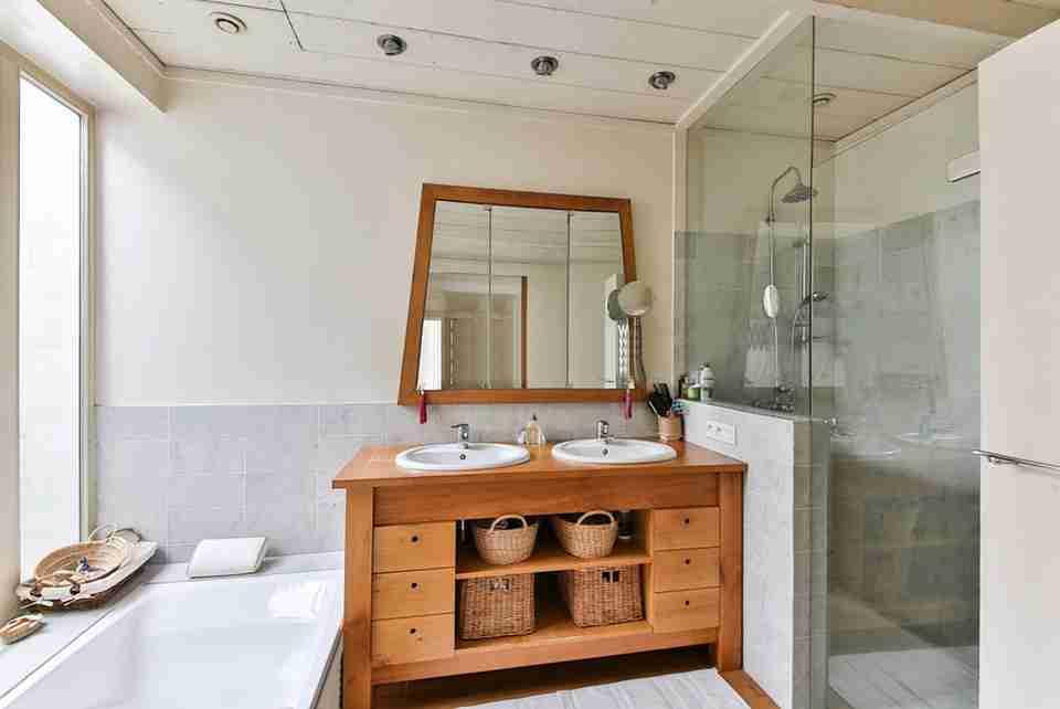 modern bathroom, walk in shower, soaker tub, wood furniture, engineered wood Increase Your Home's Resale Value