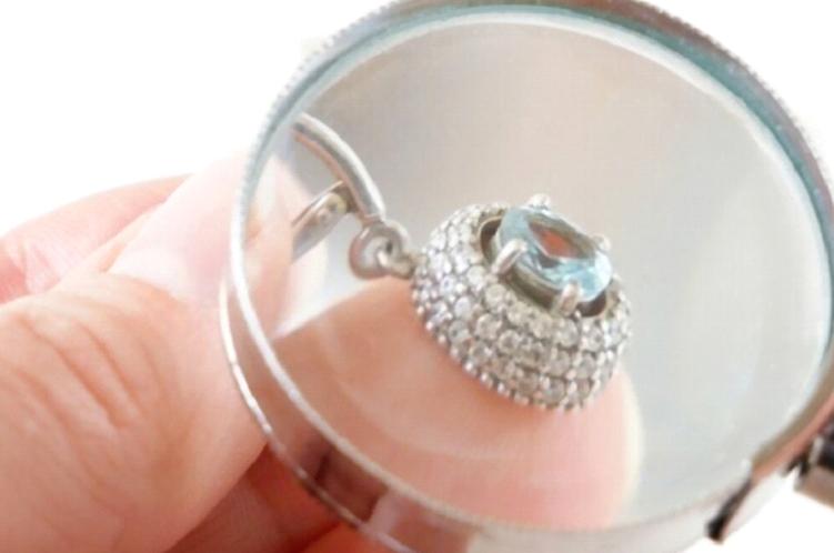 inspecting jewelry piece