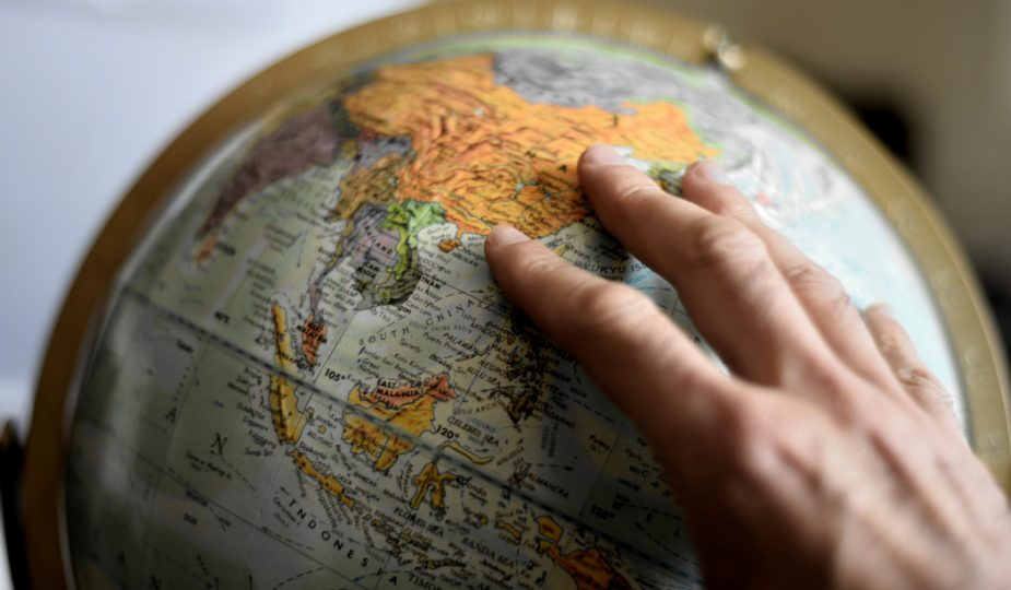 person touching a globe. A year studying abroad