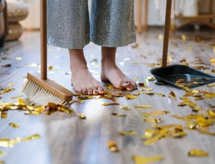 Your house chores: Child sweeping up fallen leaves