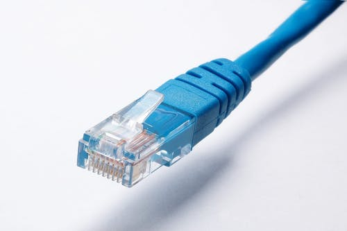 benefits of power over ethernet: blue ethernet cable.