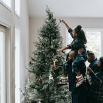 protect your wood floor from Christmas tree: family putting up Christmas tree