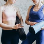 purchasing yoga wear online: 2 women wearing yoga wear and talking.