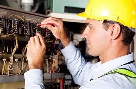 reasons to hire a level 2 electrician: electrician working on meter box wires.