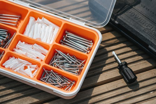 easy home improvements: DIY tool box open on wooden table.