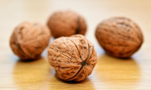 walnuts in wooden table. Best nuts for weight loss.