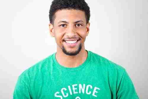 cosmetic treatments man: back man wearing green tshirt smiling.