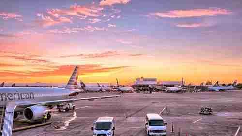 tarmac and plane: Flying to NY