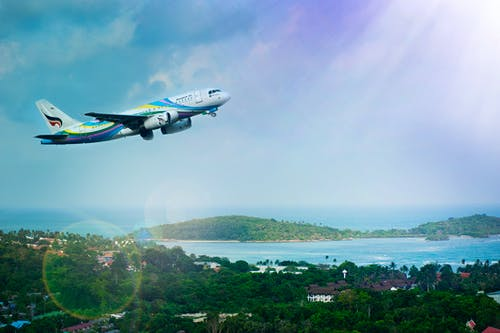 affect exchange rates: plane flying over island